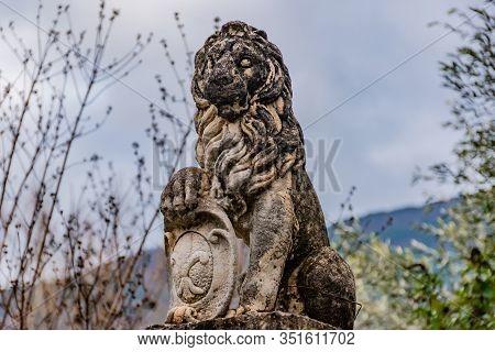 Puget-theniers, France - January 23, 2020: A Statue Of A Lion Holding The 'fleur-de-lis' Emblem ('fl