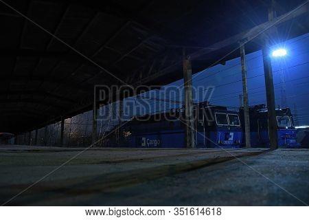 Chomutov, Czech Republic - February 08, 2020: Foggy Night On Empty Freight Train Station