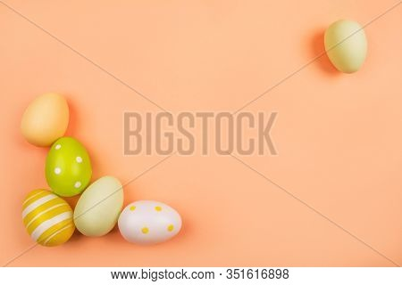 Flatlay With Dyed On Green, Yellow And White Easter Eggs Isolated On Peach Background. Easter Theme