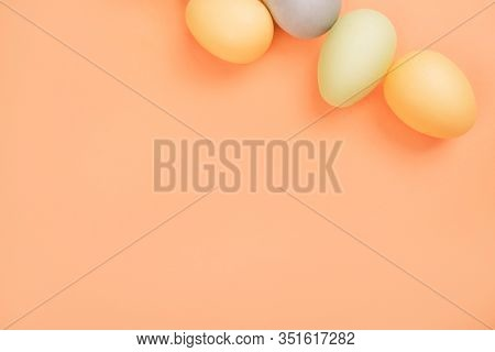 Flatlay With Dyed On Green, Yellow And Grey Easter Eggs Isolated On Peach Background. Easter Theme F
