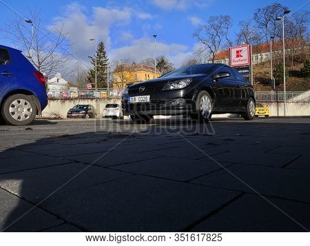 Chomutov, Czech Republic - February 11, 2020: Black Car Opel Astra On Parking Place In Front Of Kauf