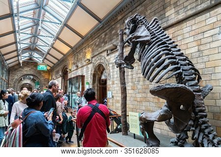 London, England - December 4, 2019: Giant Sloth Climbing A Tree Or On A Stripper Pole In Jurassic Di