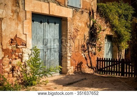 Old House With Big Light Blue Gate In One Of The Most Beautiful Villages Of France Roussillion, Prov