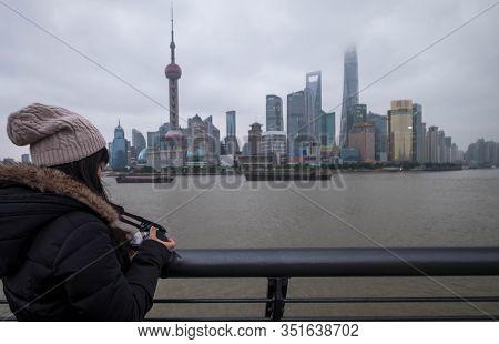 Shanghai, China - January 09 2020: The Unspecific Girl At The Shanghai Waitan