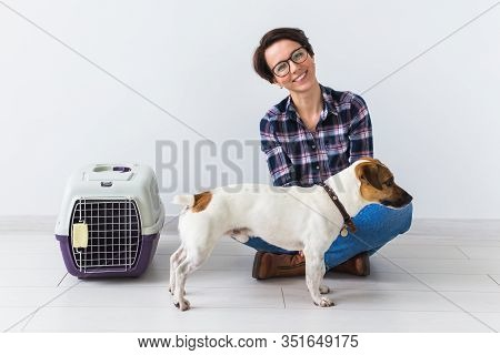 Dog Carrying Bags And Pets Owner Concept - Attractive Cheerful Female In Plaid Shirt Holds Favourite