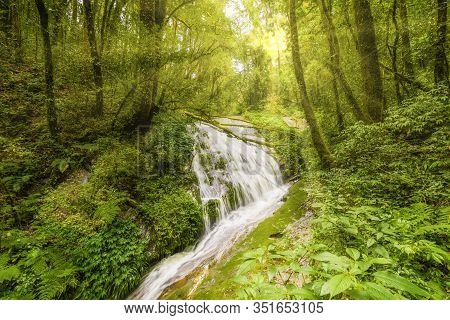 Beautiful Waterfall At Doi Inthanon National Park, Thailand. Magic Light And Sun Rays Through Trees