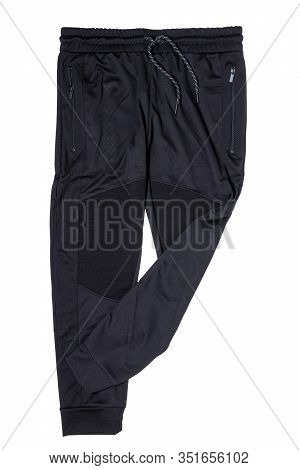 Sweat Pants Isolated. Closeup Of Mens Fashionable Black Sweat Pants Or Jersey Trousers Isolated On A