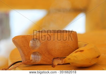 Still Life Of A Wooden Mug And Bananas On A Wooden Table. Soft, Natural, Warm Colors. Eco Friendly C