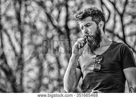 Man Long Beard Relaxed With Smoking Habit. Man With Beard And Mustache Breathe Out Smoke. Stress Rel
