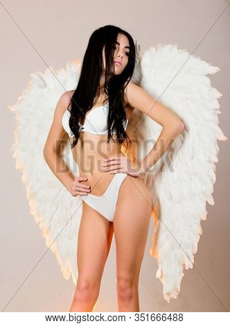 Erotic Angel. Desirable And Tempting Lady. Purity And Innocence. Attractive Sensual Woman With Angel