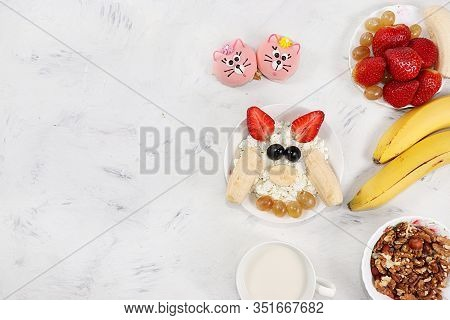 Granola, Cottage Cheese And Fresh Strawberries And Grapes On A Light Table. The Concept Of Healthy A