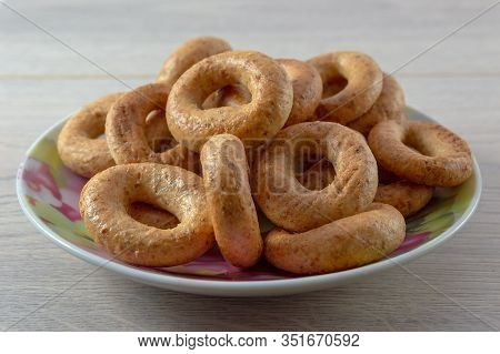 A Pile Of Bagels Bread, Sushki Or Baranki In A Plate On A Wooden Table.