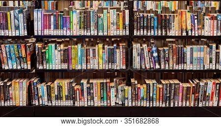 Mackay, Queensland, Australia - February 2020: Library Books On Shelves For Public Use At Dudley Den