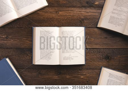 Open Books With Poems, Isolated On Wooden Background. Flat Lay, Top View, Copy Space.