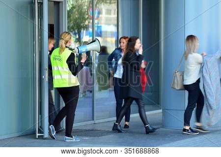 Warsaw, Poland. 15 October 2018. Evacuation Of An Office Building. People Exit The Building On Exit