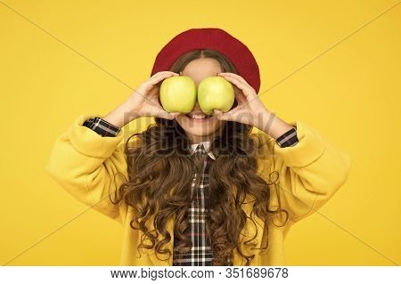Fruit Glasses. Little Girl Have Fun With Apples Fruit Yellow Background. Small Child Hold Healthy Fr