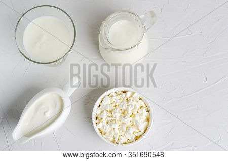 Homemade Fermented Milk Products Kefir, Cottage Cheese, Sour Cream On A White Plate With Copy Space.
