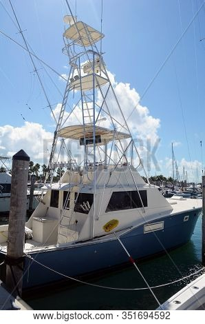 Deep Sea Charter Sport Fishing Boat With Tuna Tower Docked At A Marina On Key Biscayne,florida