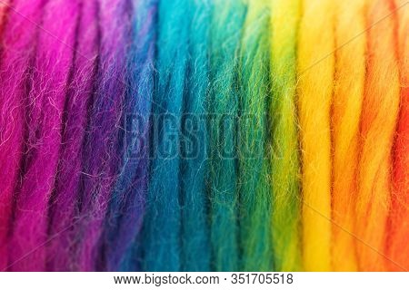 Yarn in spectrum of colors. Reel of colorful yarn. Shallow depth of field.