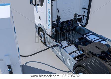 Hydrogen Logo On Gas Stations Fuel Dispenser. H2 Combustion Truck Engine For Emission Free Ecofriend