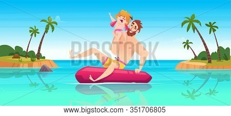 Happy Father And Daughter Float On A Lifebuoy In The Blue Sea, Having Fun. Family Vacation Concept O
