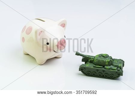 Trade War, Economic Impact Of War Or Trading Power Concept, Miniature Tank Toy Pointing The Gun At S