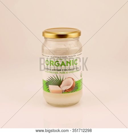 Mackay, Queensland, Australia - February 2020: A Bottle Of Organic Coconut Oil Isolated On A White B