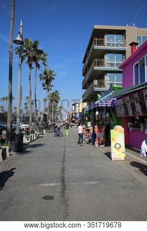 Venice Beach, California / USA - 2-17-2020: View of Venice Beach CA buildings, art projects, products for sale along the board walk. Venice Beach area is a tourist destination around the world.