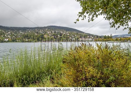 Waterside Scenery Around Gerardmer In France, A Commune In The Vosges Department In Grand Est In Nor