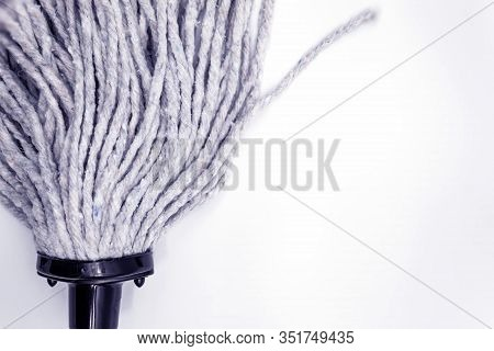 On A White Background, The Image Of A New Mop Made Of Ropes For Washing Floors In The House, Office.