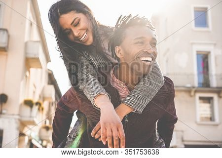 African Couple Having Fun Outdoor In City Tour - Young People Lovers Enjoying Time Together During V