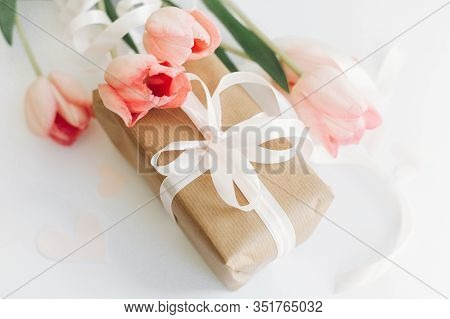 Happy Mothers Day. Pink Tulips With Ribbon And Gift Box On White Background. Stylish Soft Image Of S