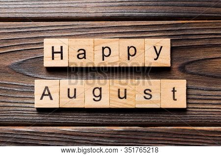 Happy August Word Written On Wood Block. Happy August Text On Table, Concept