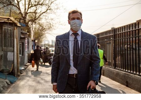 People Walking In Public Space With Pmedical Masks On To Protect Themselves From Coronavirus Infecti