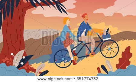 Young Loving Couple Have A Good Time, Riding Tandem Bicycle Together By The Street In The Park. Summ