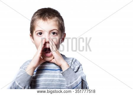 The Boy Is Loudly Calling For Help. Children Scream Out Loud. Boy Screaming Loud On A White Backgrou