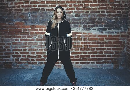 Young Beautiful Woman In Fashionable Cheeky Modern Black And White Casual Overalls