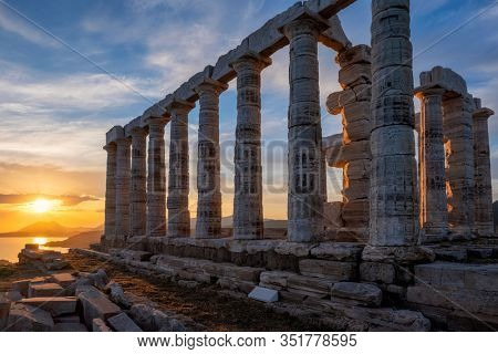 Cape Sounio : sunset at Sounion with ruins of the iconic Poseidon temple. One of the Twelve Olympian Gods of ancient Greek religion and mythology. God of the sea, earthquakes. Aegean coast, Greece.