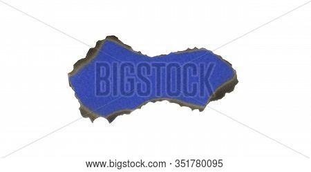 Burnt Blue Sheet Of Cardboard Isolated On A White Background. Burnt Hole In A White Sheet. Vintage C