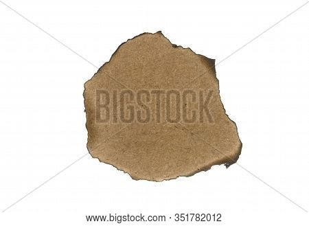 Burnt Brown Sheet Of Cardboard Isolated On A White Background. Burnt Hole In A White Sheet. Vintage