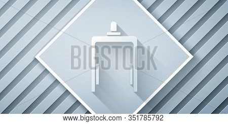Paper Cut Metal Detector In Airport Icon Isolated On Grey Background. Airport Security Guard On Meta