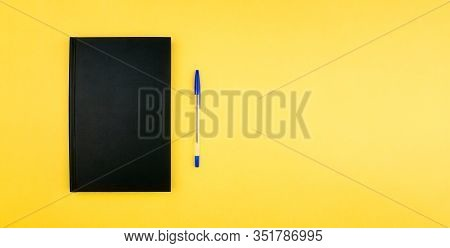 Sketchbook, Notebook And Pen Flat Lay On Colorful Yellow Background Top View With Copy Space. School