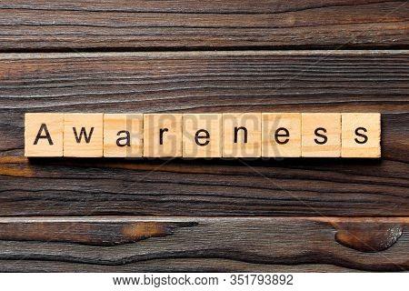 Awareness Word Written On Wood Block. Awareness Text On Table, Concept