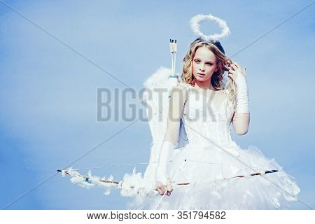 Enjoying Magic Moment. Pretty White Little Girl As The Cupid With A Bow And Arrow Congratulating On
