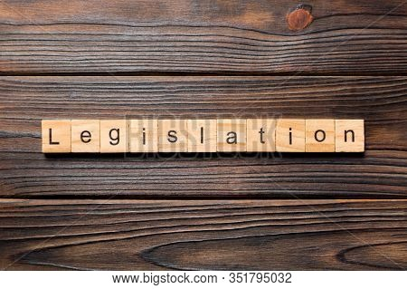 Legislation Word Written On Wood Block. Legislation Text On Table, Concept