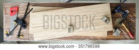 On Workbench Are Wooden Veneered Sheets And Tools. Manual Processing Blanks From Various Materials.