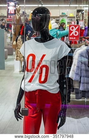Mannequin In Sale Clothes In A Store Window In A T-shirt With A