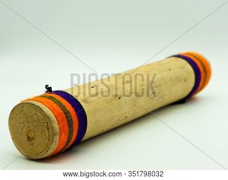 Close Up View Of Handmade Wooden Rain Sticks On A White Background. Peruvian Instrument. Ambient Sou