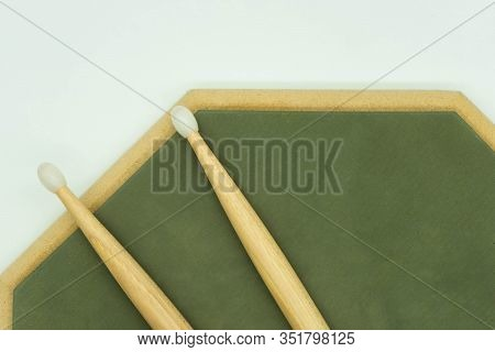 Top View Of Wooden Drumsticks On Practice Pad. Musical Instruments Concept.