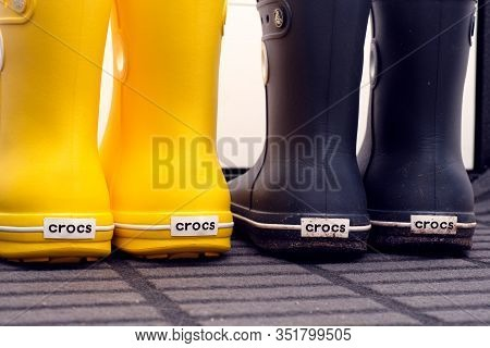 Tambov, Russian Federation - August 08, 2019 Close-up Of Two Pair Of Crocs Rubber Boots Standing In